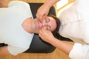 Shiatsu on the face releasing tension and clearing the mind